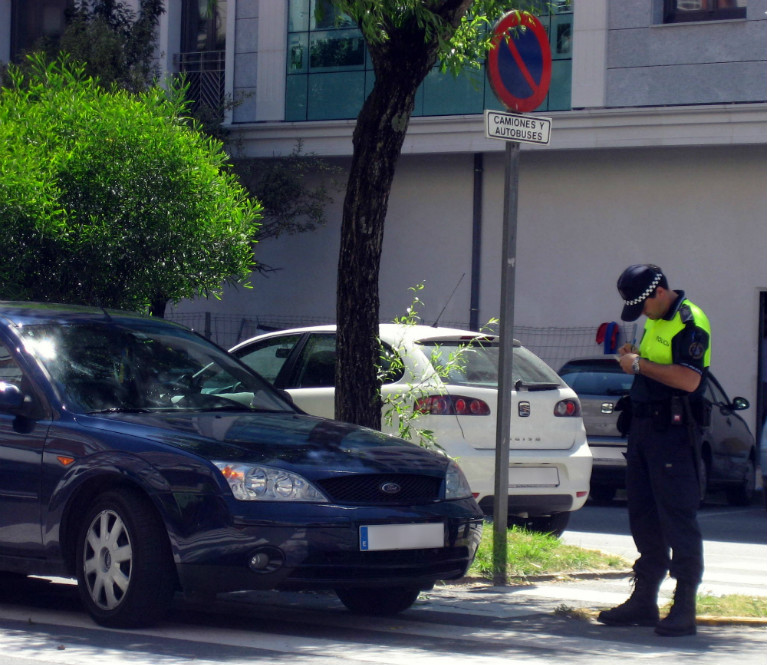 Andalucia by car: police officer fining a car
