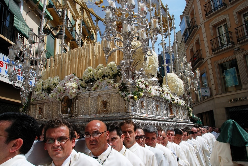 Brothers of Pollinica with throne of Virgin Mary in Malaga