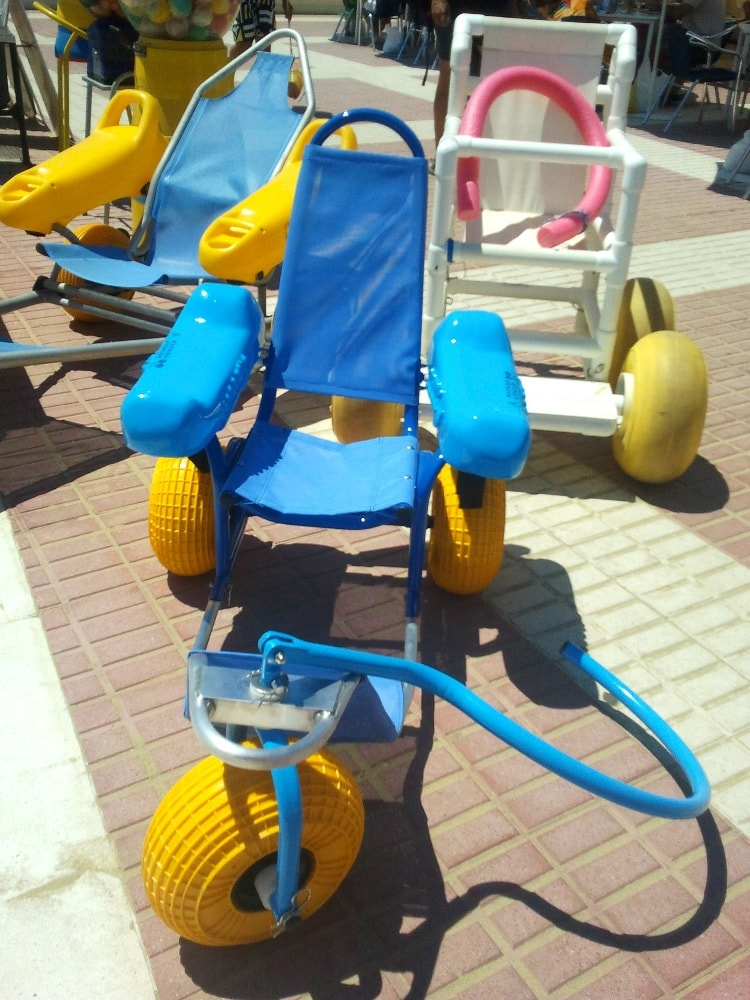 Amphibious chairs provided on the beaches of Isla Cristina