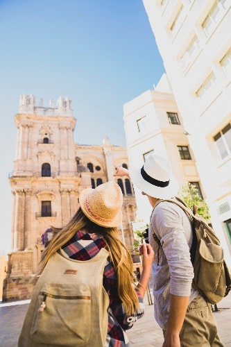 Couple in front of the Cathedral in Malaga