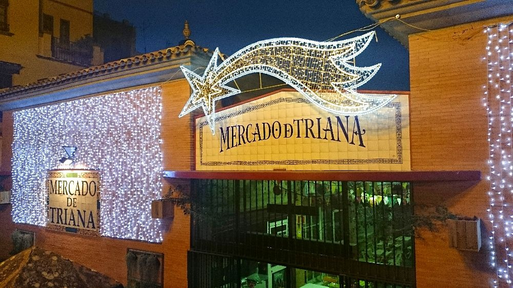 Visit Seville in winter - Triana market decorated with Christmas lights
